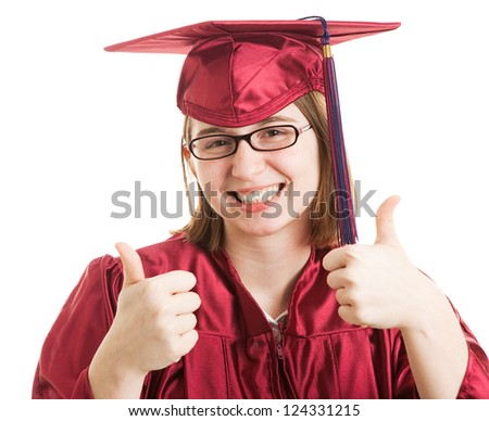Young female college or high school graduate giving the thumbs up sign.  Isolated on white. - stock photo