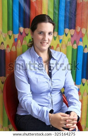 Young female college student with books - stock photo