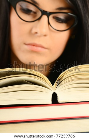 Young female college student with books. Woman reading. - stock photo
