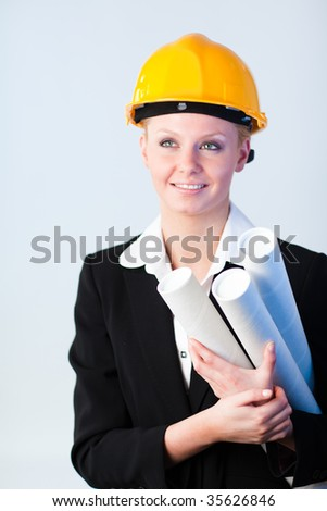 Young female constrcution worker with blueprints
