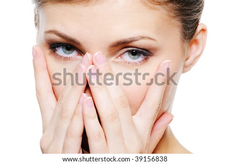 Young female cover by hands her clean face - stock photo