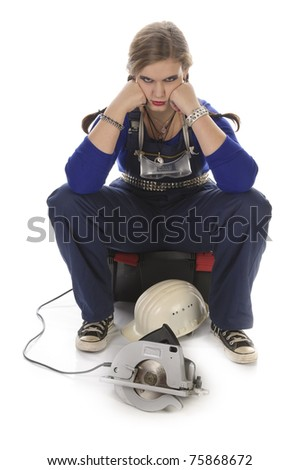 Young female craftsman with lip piercing in a blue work-suit holding tools in her hand, isolated on a white background - stock photo