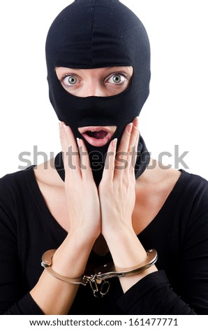 Young female criminal with handcuffs - stock photo