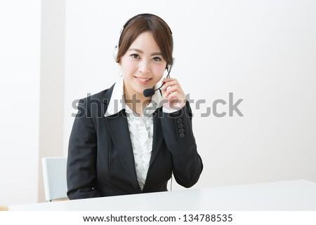 young female customer service operator - stock photo