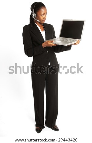 young female customer service representative with her headset on ready to work at her laptop