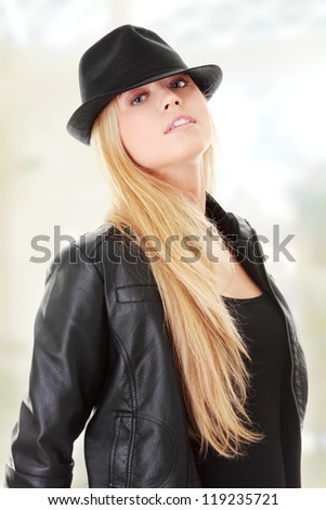 Young female dancer in black hat - stock photo