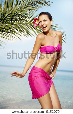 young female dancing on the beach - stock photo
