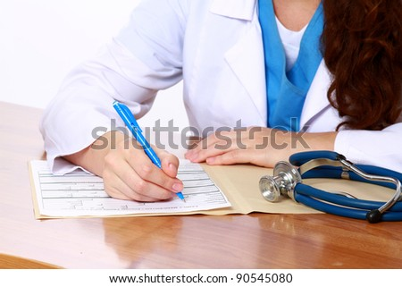 Young female doctor at desk isolated. Selective focus