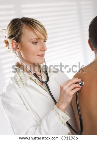 young female doctor checking men with a stethoscope