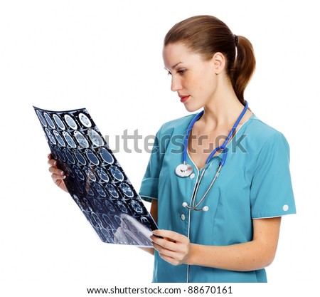 Young female doctor checking MR. Isolated over a white background - stock photo
