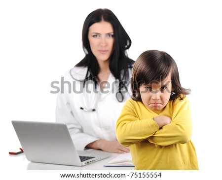 Young female doctor examining little cute angry child - stock photo