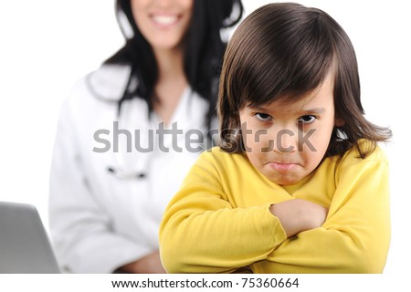 Young female doctor examining little cute angry child refusing examining - stock photo