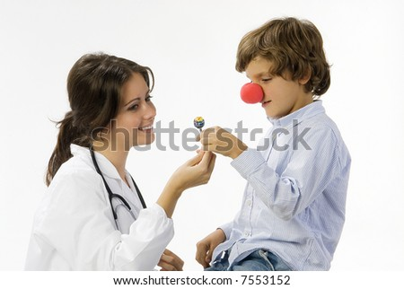 young female doctor having a sweet approach with a little boy - stock photo