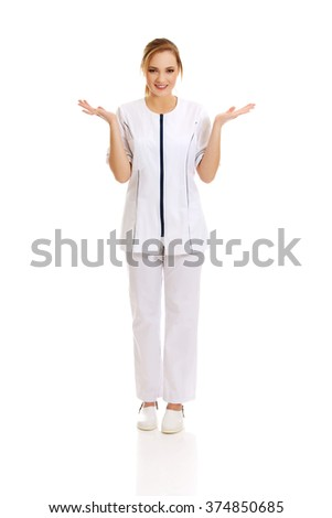Young female doctor holding an abstract space. - stock photo