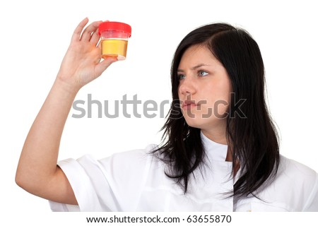 young female doctor in white workwear  keeping urine to analysis - stock photo