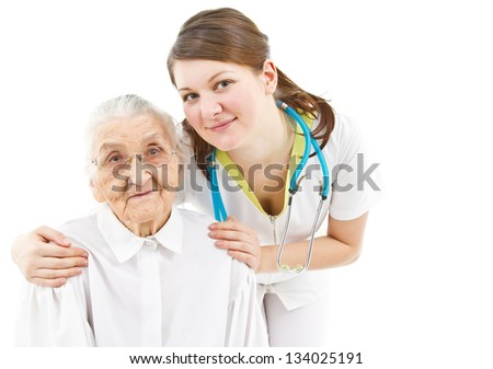 young female doctor is caring for her old  patient - stock photo