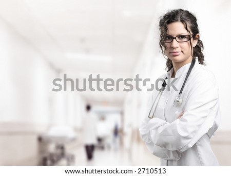 Young female doctor on the corridor of the hospital. - stock photo