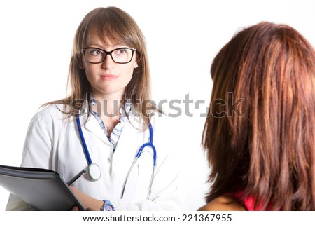 young female doctor with a patient - stock photo