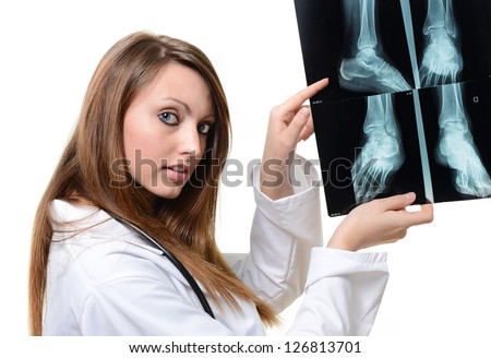 young female doctor with x-ray in hand over a white background - stock photo