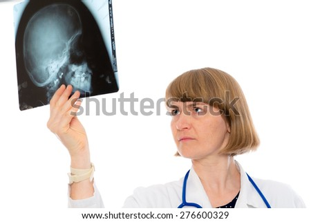 young female doctor with X-ray photograph in front of white background - stock photo