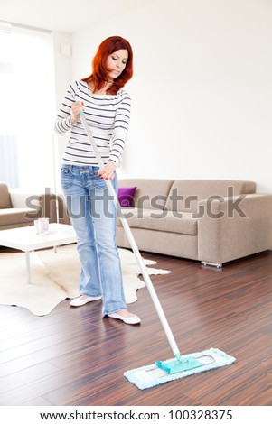 Young female doing housework - stock photo
