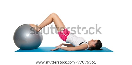Young female doing workout and exercising on a blue matt. Isolated on white. - stock photo