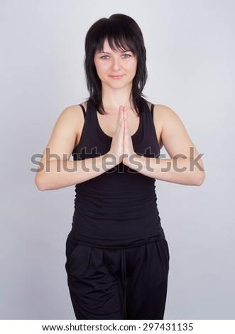 Young female doing yoga exercise   - stock photo