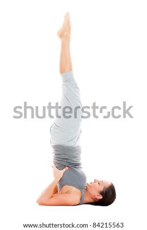 young female doing yoga exercise on floor. isolated on white background - stock photo