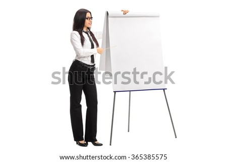 Young female employee pointing on a presentation board with a stick isolated on white background