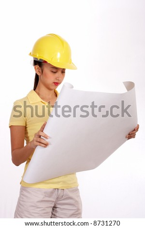 young female engineer analyzing a floor plan - stock photo