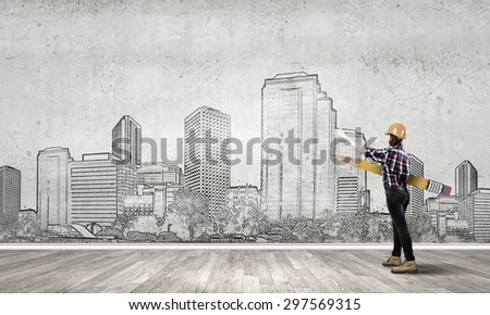 Young female engineer in hard hat with big pencil - stock photo