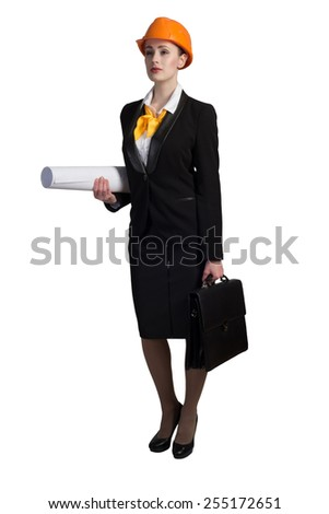Young female engineer with suitcase in hardhat isolated on white - stock photo