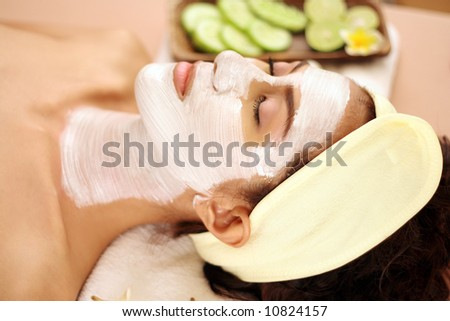 young female enjoying a facial beauty treatment.