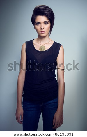 Young female fashion model posing for a studio shot