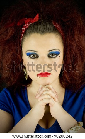 young female fortune teller with hands together - stock photo