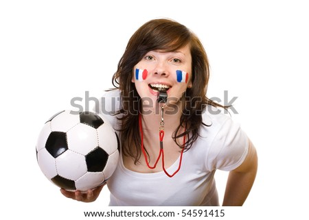young female french team fan with football ball and whistle, also small flags painted on her cheeks, studio shoot isolated on white background