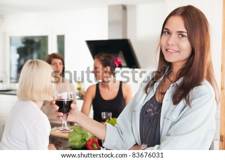 Young female friends having a casual party at home - stock photo