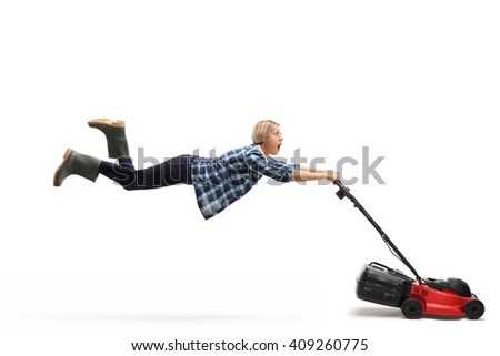 Young female gardener being pulled by a powerful lawnmower isolated on white background