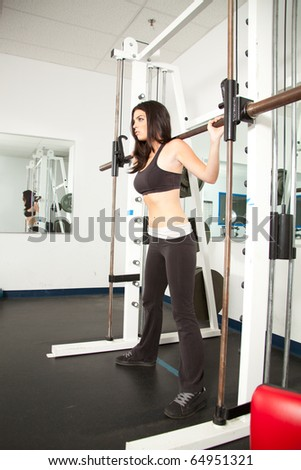 Young female getting fit by working out - stock photo