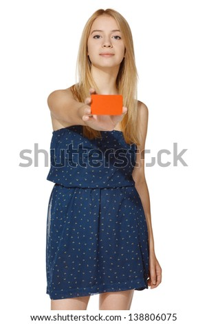 Young female giving you a blank credit card, over white background - stock photo