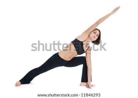 Young female gymnast practicing yoga. - stock photo