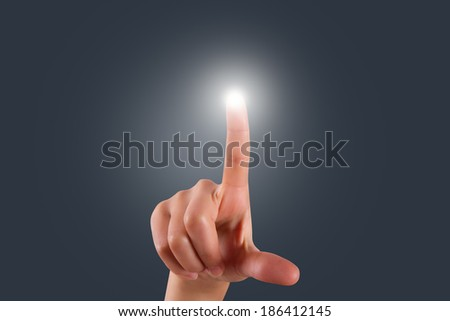 Young female hand finger touching or pressing digital screen on air. - stock photo