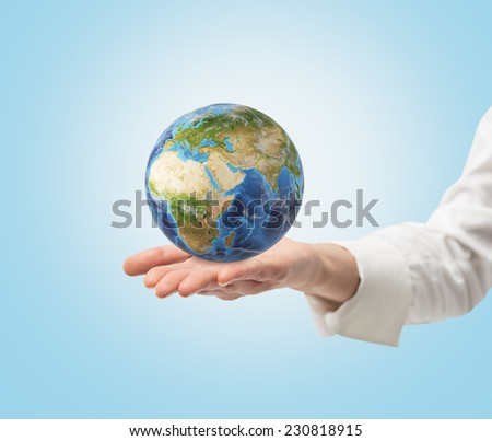 Young female hand holding a globe. frica and Asia view. Elements of this image furnished by NASA  - stock photo