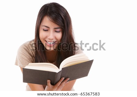 Young female happily reading book, isolated on white - stock photo