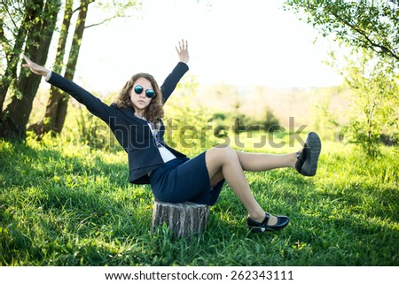 young female having fun on flowery meadow - stock photo