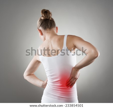 Young female having nerve pain. Chronic kidneys disease indicated with red spot on woman's body. - stock photo