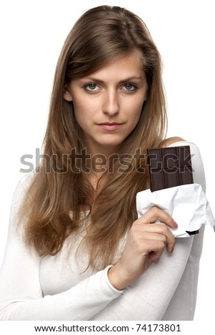 Young female holding chocolate in bars looking at the camera isolated on white background - stock photo