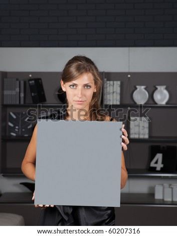 Young female holding empty banner - stock photo