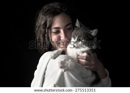 Young female holding her cat - stock photo
