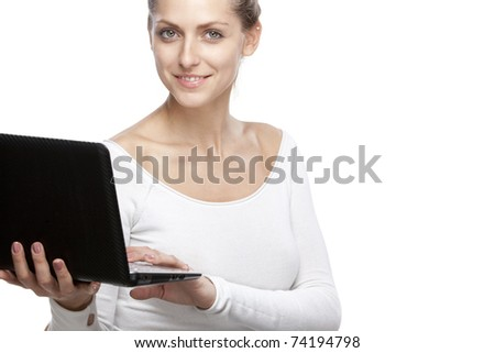 Young female holding laptop isolated on white with copy-space - stock photo